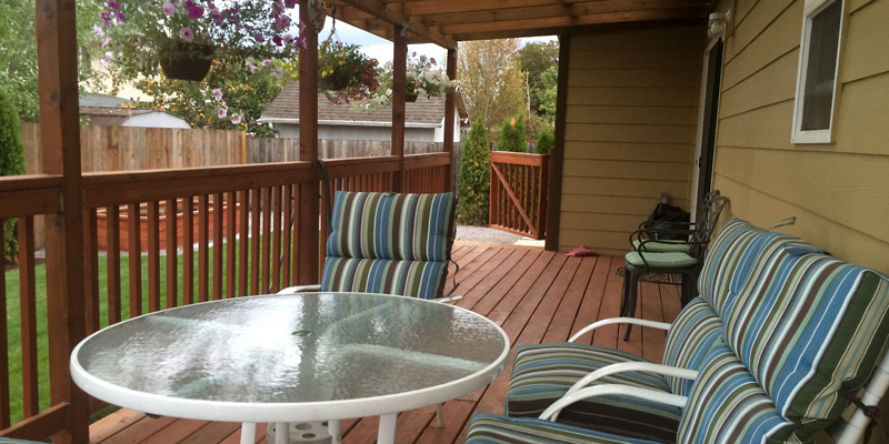 We have a covered porch to enjoy the backyard garden and birds.